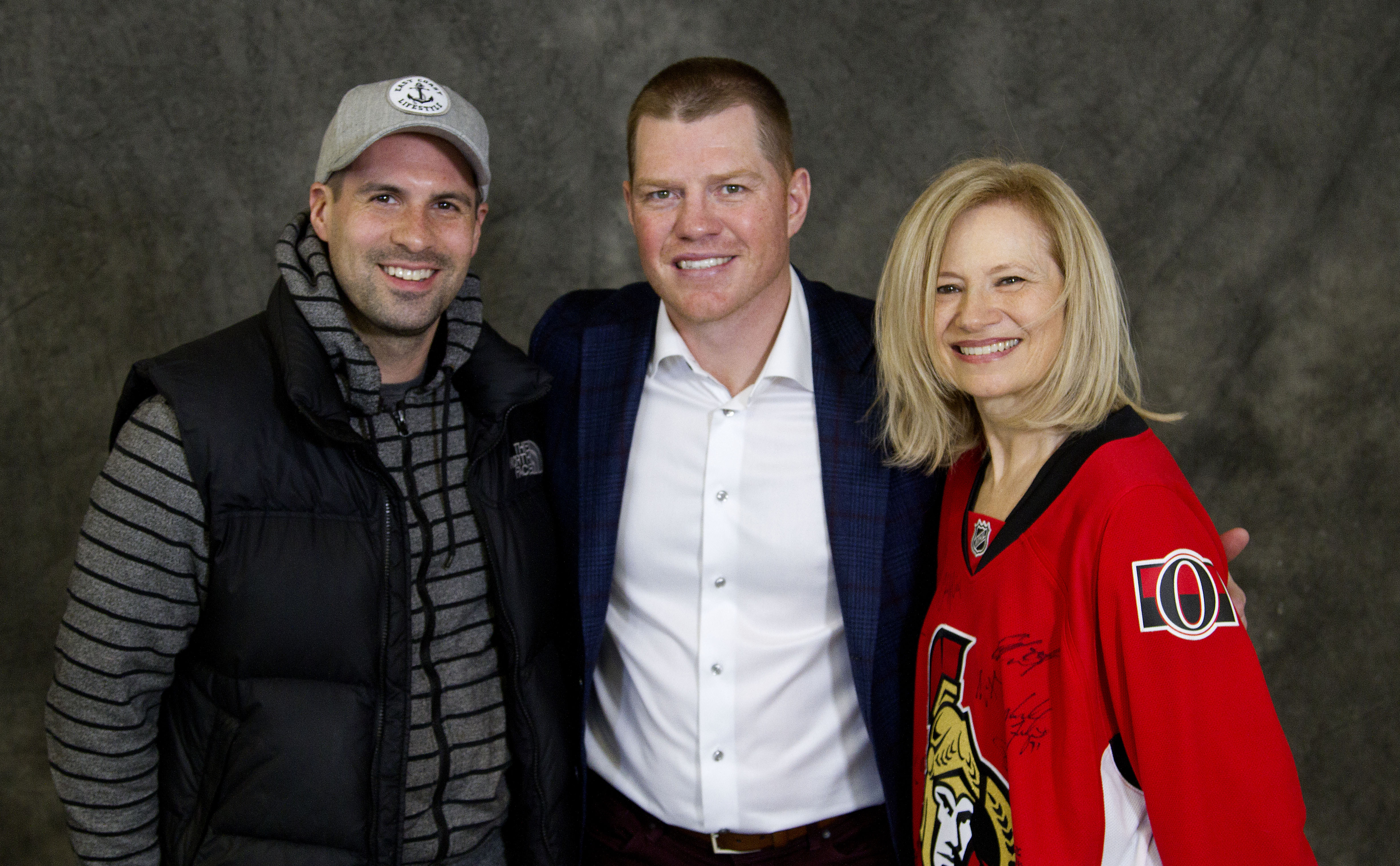 Professional hockey player, Chris Neil, with a PPRA board member on either side.